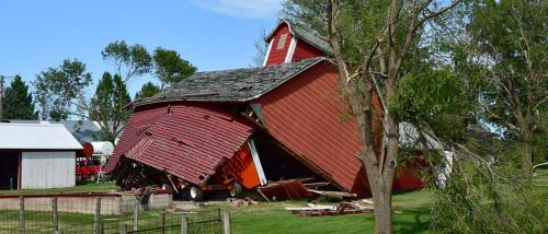 Red barn destroyed by storm.